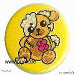 Damaged teddy badge